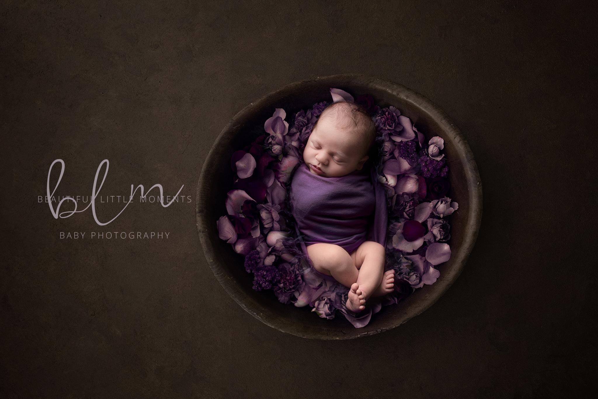 newborn-boy-brown-purple-bowl-flowers-crop